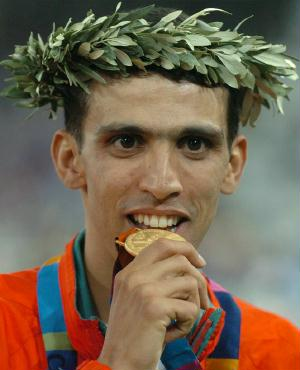 http://optimaltraining.typepad.com/photos/uncategorized/2008/05/27/hicham_el_guerrouj_gold_3.jpg